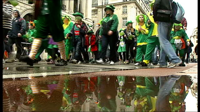 thousands turn out for st patrick's day parade in london; low angle of st patrick's day parade vox pop participant in parade - participant stock videos & royalty-free footage