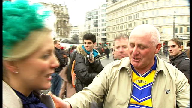 Thousands turn out for St Patrick's Day parade in London Vox pop Participant in parade as puts his wig on ITN reporter's head Back view of little boy...