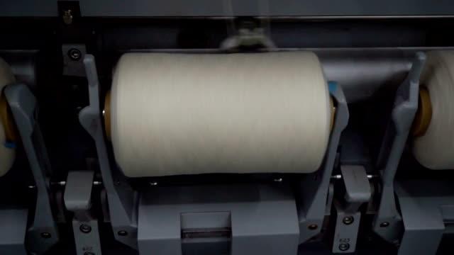 thread machine spinning yarn onto yarn tube - ball of wool stock videos & royalty-free footage