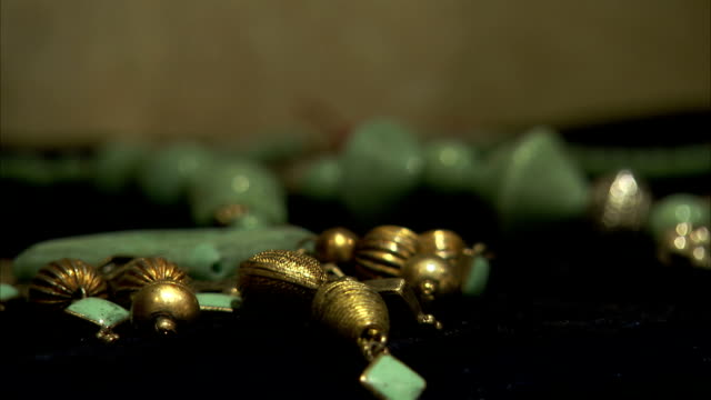 threaded beads cover a table in a shop in india. - jewellery stock videos & royalty-free footage