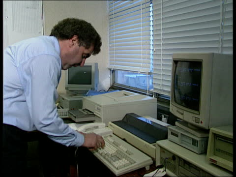 threat from computer virus 'michelangelo' england london scotland yard ms men working and on phone in computer crime office cms man working at vdu... - vintage computer monitor stock videos & royalty-free footage