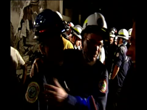 vídeos de stock, filmes e b-roll de threat of gangrene during rescue effort rescue worker holding up rehydration pack rescue worker's hand stroking little girl's head rescue workers... - 50 segundos ou mais
