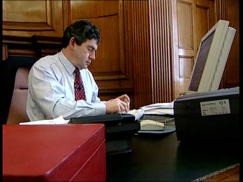 stockvideo's en b-roll-footage met threat of tax on savings lib london downing street number 11 int chancellor gordon brown mp working at desk - number 9