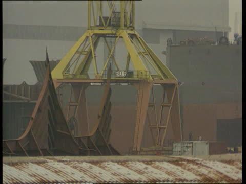 threat to shipyard jobs; lib northern ireland: belfast: ext tgv large gantry cranes at harland & wolff shipyard lms crane moving lms ship seen... - shipyard stock videos & royalty-free footage