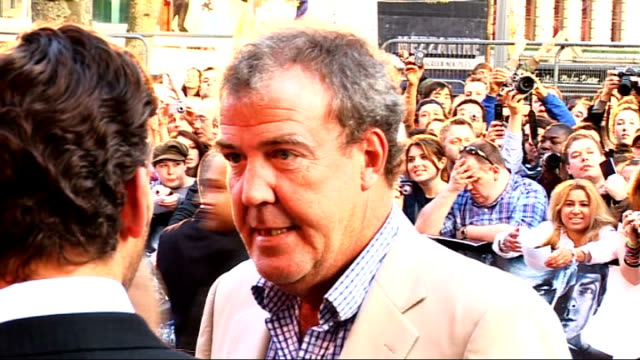bbc threatened with licence fee cut by grant shapps lib leicester square ext jeremy clarkson on red carpet at star trek film premiere - fee stock videos & royalty-free footage