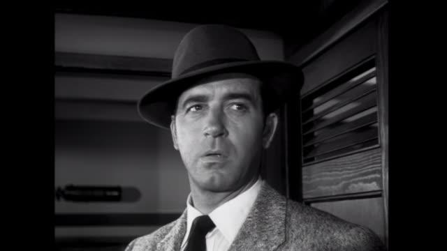 1952 threatening gangsters corner a man in a boat - 様式点の映像素材/bロール