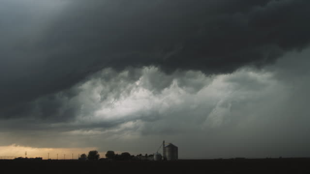 Threatening time-lapse storm clouds over a grain silo