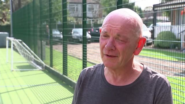 fifa threatens legal action against walking football world cup organisers over name england ext paul carr wearing 'fifwa' cap set up shots with... - t shirt stock videos & royalty-free footage