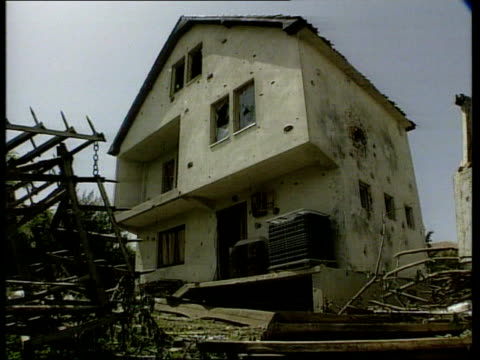 stockvideo's en b-roll-footage met threatens military force if ceasefire fails; itn kosovo: hade gv smoking derelict building gv damaged house hole in wall of house rubble of damaged... - war and conflict