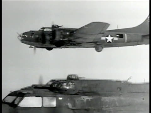 three 303rd bombardment group, 8th air force b-17 'flying fortress' bombers in flight , varying altitude, up/down, flak evasive maneuvers. - bomber stock videos & royalty-free footage