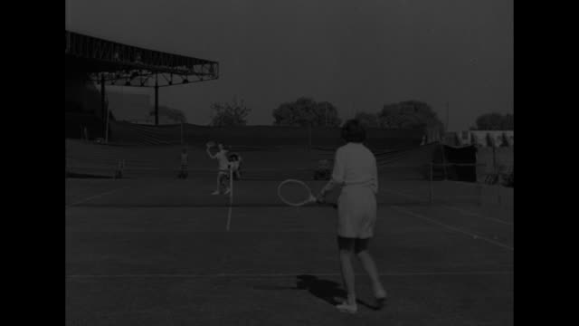three action shots of game between us tennis players gertrude moran and patricia todd / moran on left and todd take break between sets / moran serves... - newsreel stock videos & royalty-free footage