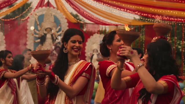 three adult women celebrating durga puja, kolkata, west bengal - kolkata stock videos & royalty-free footage