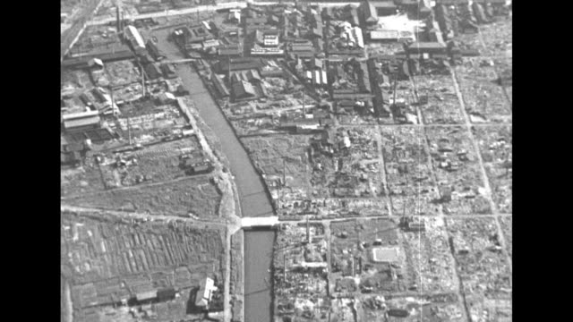 three aerial shots of damaged and wrecked buildings in hamburg / three aerial shots of damaged and wrecked buildings around harbor / note exact... - ruine stock-videos und b-roll-filmmaterial