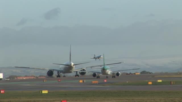 Three Aeroplanes at a busy Airport - HD & PAL