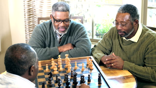 three african-american men playing chess - chess piece stock videos & royalty-free footage