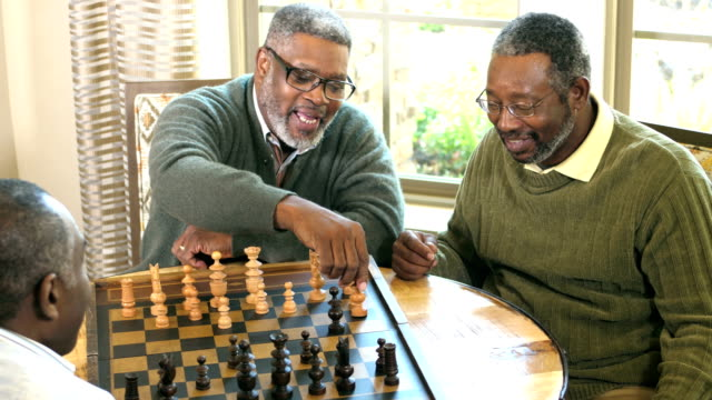 three african-american men playing chess - chess stock videos & royalty-free footage