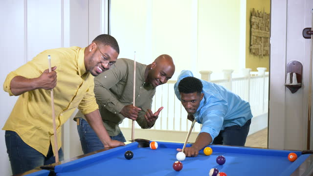 three african-american men shooting pool, giving advice - mid adult men stock videos & royalty-free footage