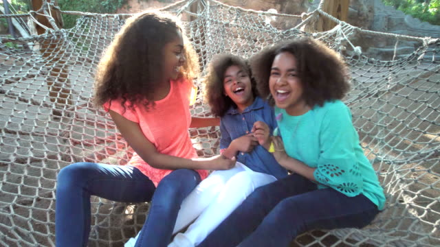 three african-american sisters having fun on playground - 12 13 years stock videos & royalty-free footage