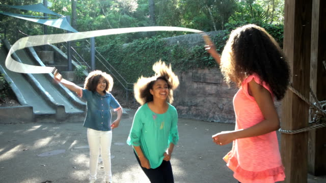 three african-american sisters jumping rope - family with three children stock videos & royalty-free footage