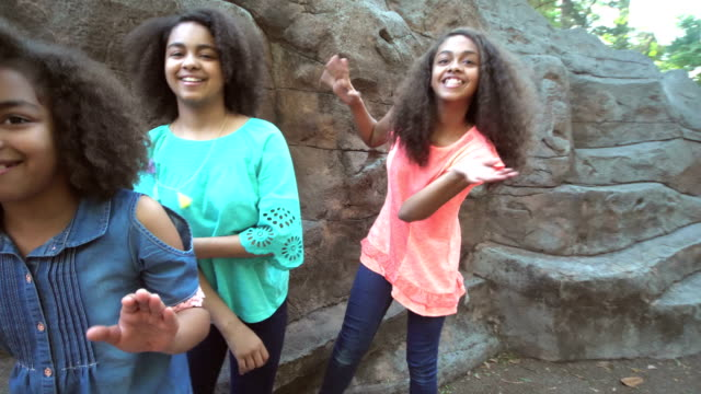 three african-american sisters playing hide and seek - 12 13 years stock videos & royalty-free footage