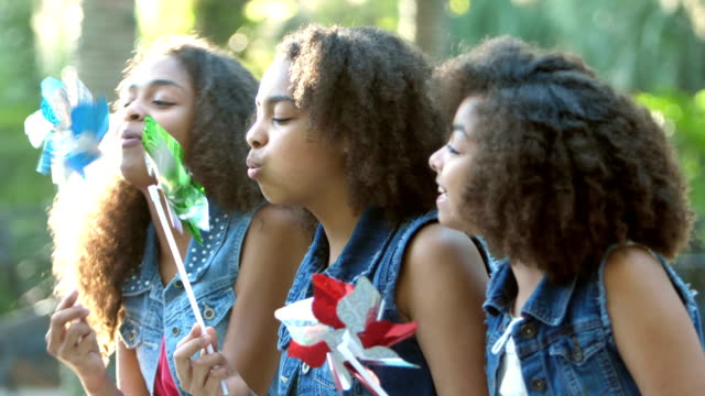 three african-american sisters playing with pinwheels - 12 13 years stock videos & royalty-free footage