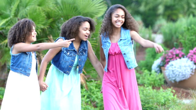 three african-american sisters walking in garden - 12 13 years stock videos & royalty-free footage