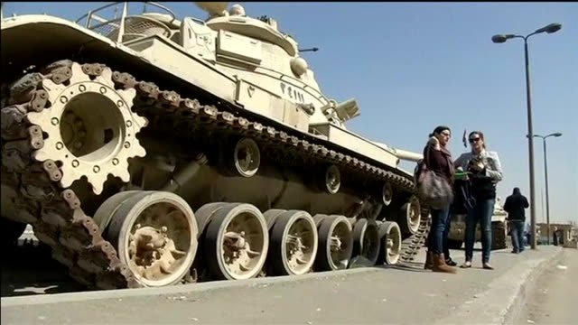 three al jazeera television journalists go on trial; egypt: cairo: ext tank in road people standing next to tank rifles being held by police officers... - crime or recreational drug or prison or legal trial stock-videos und b-roll-filmmaterial