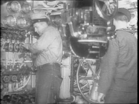 stockvideo's en b-roll-footage met three american submarines in the water for a training cruise / cameraman on the deck of a submarine / aerial views of a submarine in the water / a... - machinekamer