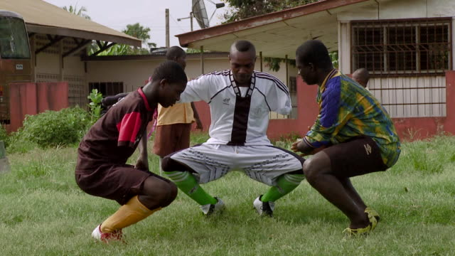 three amputee soccer players squat as part of their workout. available in hd. - ghana stock videos & royalty-free footage