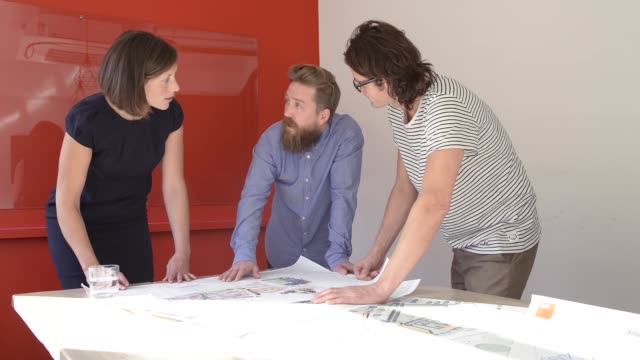 three architects looking at design drawings. - bournemouth england stock videos & royalty-free footage