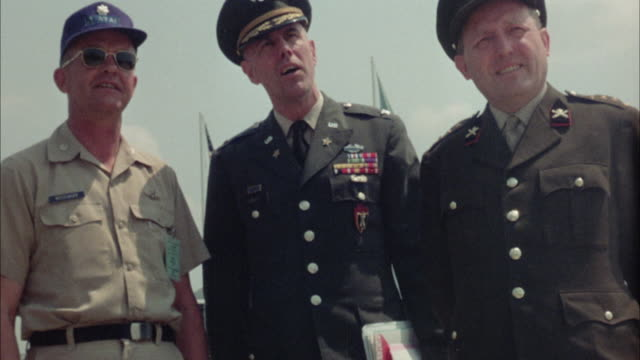 1967 MS Three army officers standing and talking outdoors