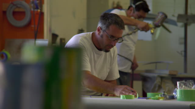 ms pan three artists working in workshop, malibu, california, usa - airbrush stock videos & royalty-free footage