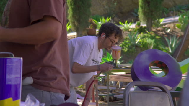 ms three artists working outdoors, malibu, california, usa, ds - airbrush stock videos & royalty-free footage