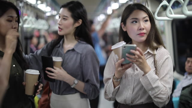 three asian women riding in the subway train - dependency stock videos & royalty-free footage
