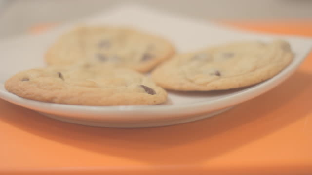 three baked chocolate chip cookies - chocolate chip cookie stock videos and b-roll footage