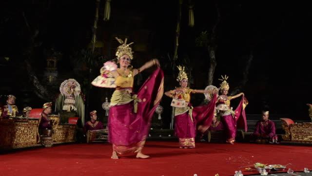 MS TS Three balinese girl dancer is performing Tari Penyambutan Dance ( Goddess of Moon ) in Puri Saraswati temple AUDIO / Ubud, Bali, Indonesia, Asia
