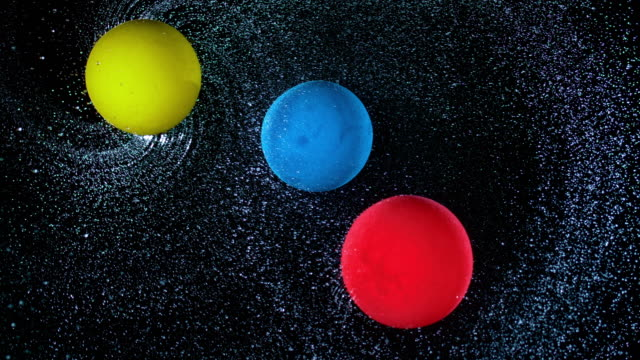 slo mo ld three balloons rotating across the sky, spraying water and bumping into each other - three objects stock videos & royalty-free footage
