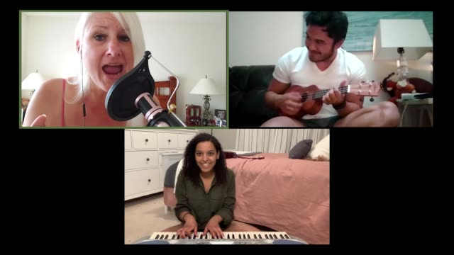 three bandmates practice playing music together via video call. - musician stock videos & royalty-free footage