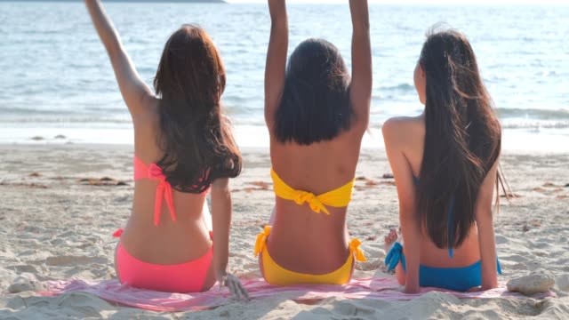 Three beautiful girls having fun on the beach.summer holidays, travel, people and vacation concept.Vacations - iStock
