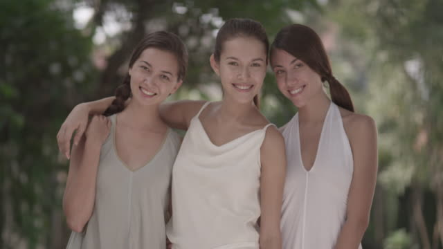 stockvideo's en b-roll-footage met three beautiful woman doing friends forever poses together. - onderdeel van een serie