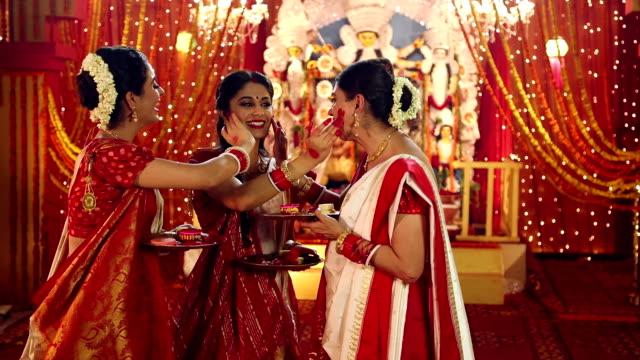 three bengali women celebrating durga puja festival, delhi, india - bindi stock videos and b-roll footage