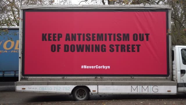 three billboard vans with messages calling labour racist and anti-semitic are parked outside the launch of the labour party manifesto on race and... - billboard stock videos & royalty-free footage
