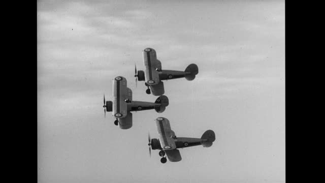 three biplanes performing stunts in tandem. air-to-air footage of biplanes stunt flying on january 01, 1930 - arrangement stock videos & royalty-free footage