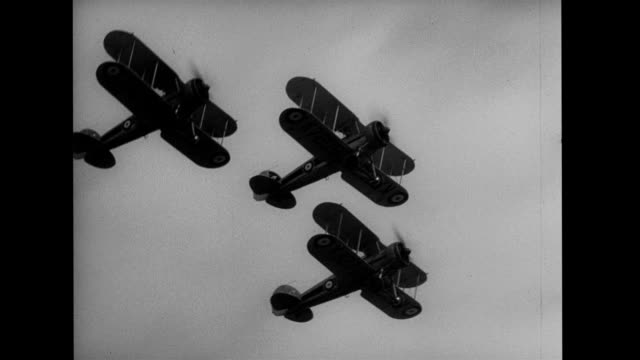 three biplanes performing stunts in tandem / three biplanes landing in a field at the same time. air-to-air footage of biplanes stunt flying on... - small group of objects stock videos & royalty-free footage