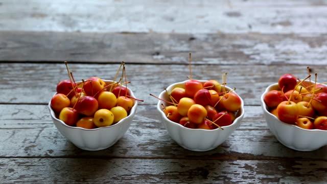 three bowls fresh ripe organic crabapple - fruit bowl stock videos & royalty-free footage