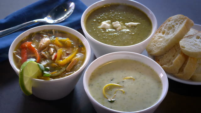 Three Bowls of Soup With Bread