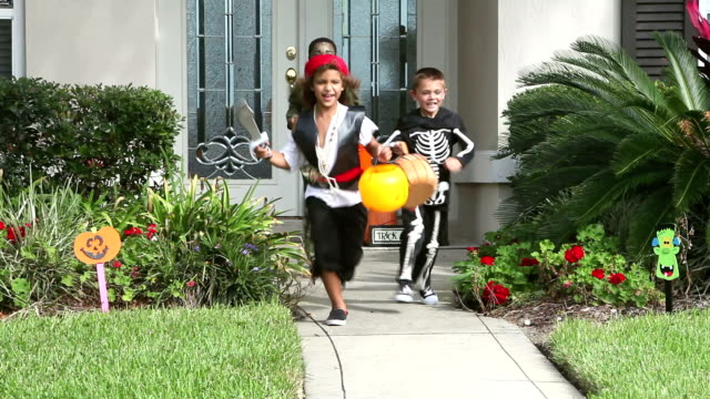three boys in halloween costumes, trick or treating - jack o' lantern stock videos and b-roll footage