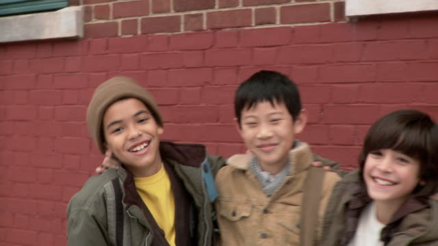 three boys outside school - drei personen stock-videos und b-roll-filmmaterial