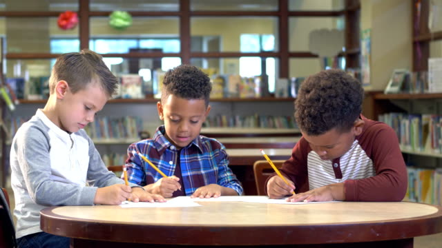 three boys studying in the library - mixed race person stock videos & royalty-free footage
