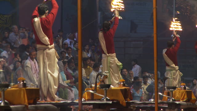 Three Brahmin Priests with candles